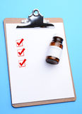 Clip Board with Prescription Bottle and Check Boxes Royalty Free Stock Photography