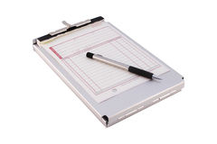 Clip Board & Sales Order Form. A folding metal clipboard with a Sales Order slip and metal barrel mechanical pencil on top. Isolated on a white background Stock Photo