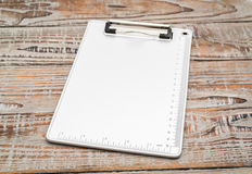 Clip board on wood  background . Stock Images