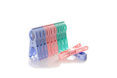 Clip clothespin. Several colored plastic clothespins with white background Stock Photos