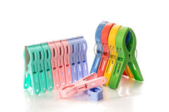 Clip clothespin. Several colored plastic clothespins with white background Royalty Free Stock Photography