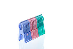 Clip clothespin. Several colored plastic clothespins with white background Stock Image