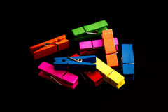 Clip colorful. Many colorful clip made of wood on black background Stock Photography