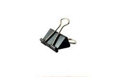 Clip de papel negro aislado en el fondo blanco Imágenes de archivo libres de regalías