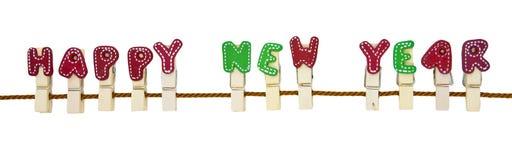 Clip di legno di nuovo anno felice sulla corda Fotografia Stock