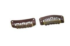 Clip en clips de la extensión - marrón Fotografía de archivo