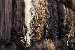 Clip-in hair extensions in wig shop Stock Image
