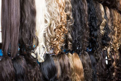 Clip-in hair extensions in wig shop Royalty Free Stock Image