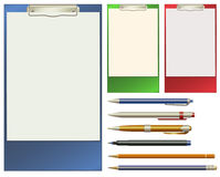 Clip Pad and Pens. Vector clip pad with a blank sheet of paper, and a group of pens and pencils Royalty Free Stock Photos