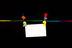 Clip Paper. Paper clip with bright colors with colored rope Stock Photos