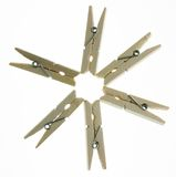Clip star 6. Four isolated wooden clothespins in a star Royalty Free Stock Images