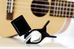 Clip tuner Equipment For tuning the ukulele guitar sound. Stock Photography