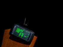 Clip tuner for Guitar. A sound Stock Image