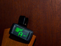 Clip tuner for Guitar. A sound Stock Images