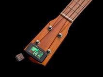 Clip tuner for ukulele , A sound. Clip tuner for ukulele on black background , A sound Stock Photos