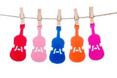 Clip on a  twine , hanging colorful  Guitar Violin music Royalty Free Stock Photos