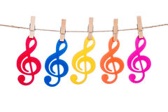 Clip on a twine , hanging colorful music clef. Artist royalty free stock photography