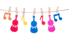 Clip on a  twine , hanging colorful music symbol and Guitar Stock Image