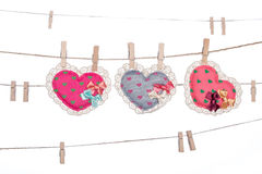 Clip on a  twine , hanging  heart valentine's day Royalty Free Stock Photo