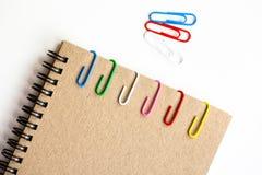 Clip y cuaderno Foto de archivo