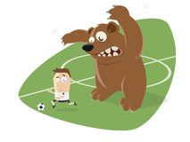 Russian bear behind a football player Royalty Free Stock Photos