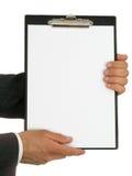 clipboard бизнесмена вручает удерживание s Стоковая Фотография