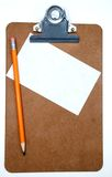 Clipboard. A pencil, blank note and clipboard royalty free stock photos