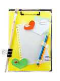 Clipboard. Office clipboard with colorful paper sheets and hearts with clips and art tools Stock Photography