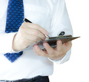 Clipboard. Business man writing on clipboard , isolated on white background Stock Photography