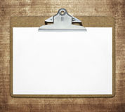 Clipboard. With blank sheet of paper on wooden table Stock Images