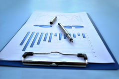 Clipboard with analytical graphs Stock Photos