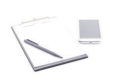 Clipboard black color and smartphone, pen. Stock Photo