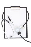 Clipboard with blank paper sheet, stethoscope and sphygmomanomet Royalty Free Stock Image