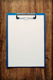 Clipboard with a blank sheet of paper Stock Images