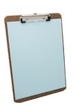 Clipboard and blue paper. Wooden clipboard and blue blank paper Stock Photography