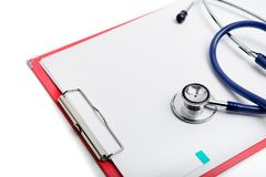 Clipboard with blue stethoscope. Health diagnostic concept. Red clipboard with blue stethoscope on white background. Health diagnostic concept royalty free stock images