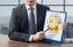 Clipboard with business icons Stock Photos