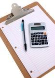 Clipboard and calculator Stock Photos