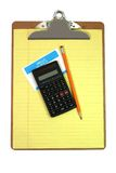 Clipboard, Calculator, Pencil, Name Tag, and Paper Stock Photo