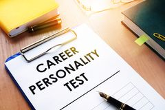 Clipboard with Career personality test on an desk. Assessments concept. Clipboard with Career personality test on an office desk. Assessments concept Stock Image