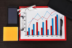 Clipboard with chart. On table and business object Royalty Free Stock Photography