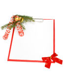 Clipboard with Christmas decoration. Clipboard with blank paper for messages and Christmas ornaments on a white background Royalty Free Stock Photo