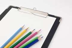 Clipboard and colored pencils. Royalty Free Stock Photo