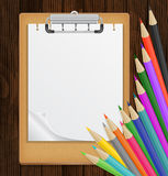 Clipboard with colorful pencils Royalty Free Stock Photography