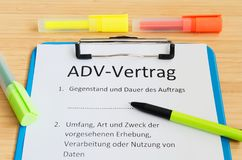 Clipboard with a contract and inscription in german ADV-Vertrag in english ADV contract and subject matter and duration of the con stock image