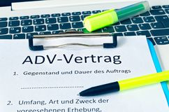 Clipboard with a contract and inscription in german ADV-Vertrag in english ADV contract and subject matter and duration of the con. Tract and scope type and royalty free stock photo