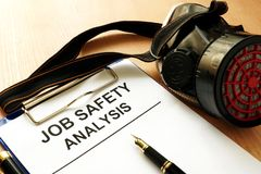Job safety analysis. Clipboard with document Job safety analysis Royalty Free Stock Images
