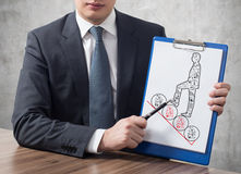 Clipboard with drawing man Stock Photo