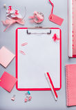 Clipboard with empty copy space blank for list or  for input the text, flowers and other supplies, Top view, flat lay. Modern femi. Nine office desk table in Royalty Free Stock Images