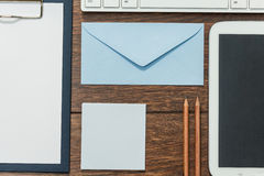 Clipboard, envelope and tablet Stock Photo